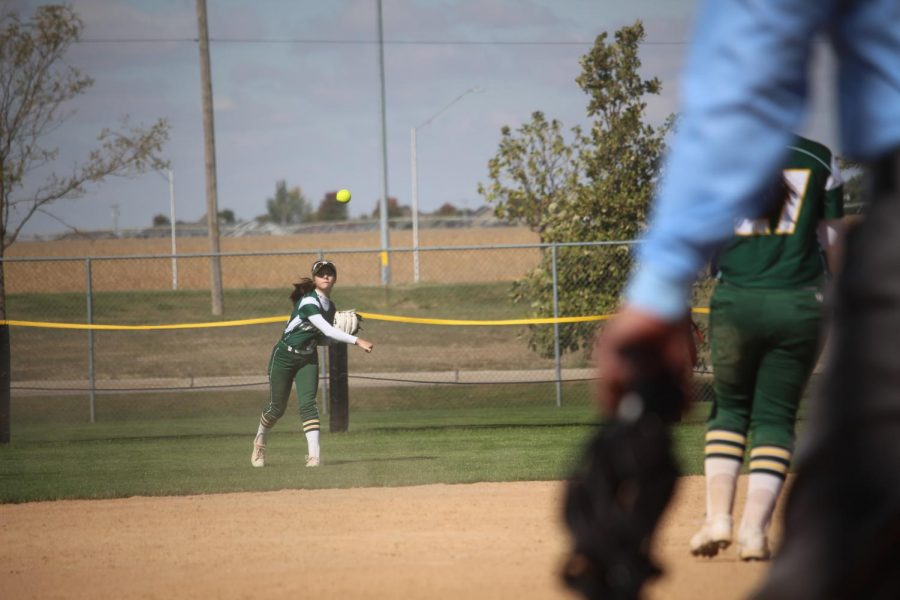 Throwing the Ball; Krystal Russ (24) gets thrown into a varsity game, even though she didn't expect to play.