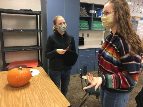 "Before painting their Pumpkin, Laynie Aure (22) and Grace Russell (22) discuss ideas. ""We painted the mime from Tangled,"" Russell (22) said. ""It seemed French."" They named their pumpkin Petunia, after John Mulaney"