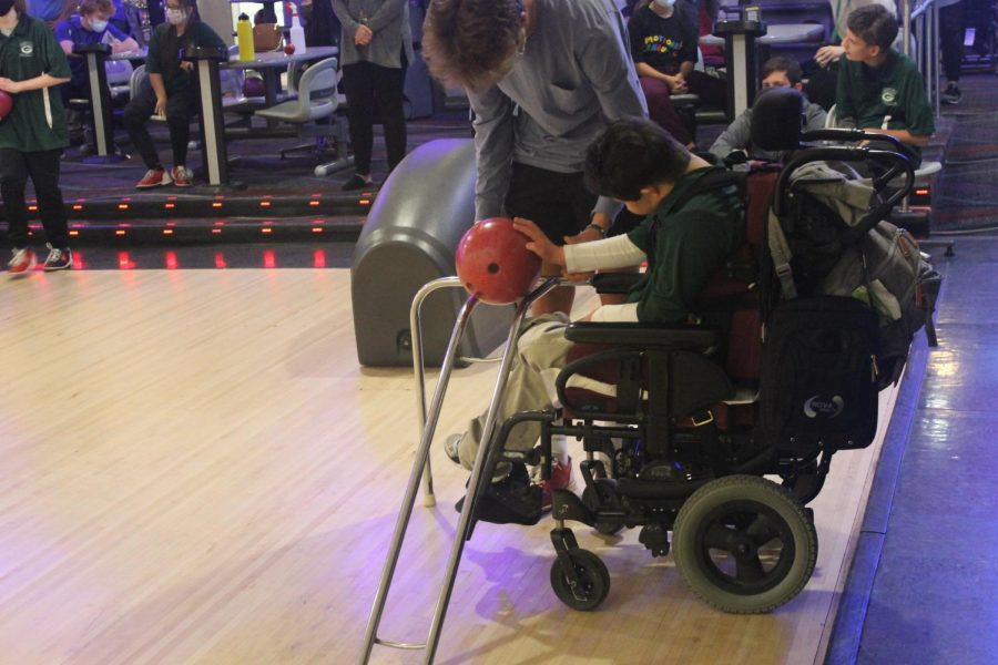 "Rock and Roll: With the assistance of Paul Kramer (22), Daniel Kirchner (18) sends his ball barreling towards the pins. ""I like seeing the kids, and how excited they get, and how much fun they have."" Kramer said. In addition to helping, Kramer also bowled."
