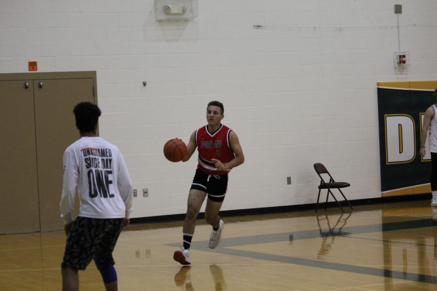 One on One: Driving into the lane senior Colton Stock prepares for a lay-up.