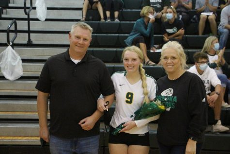 "DRAGON POWER Before the volleyball team took on Millard South, Josie Mason (21) is recognized on senior night along side her parents and the rest of the seniors. ""I have been playing volleyball since 2nd grade and played multiple sports growing up which I think benefited me now,"" Mason said. ""I was able to learn time management and some important life skills through these activities."" Mason is keeping her options open and is currently undecided."