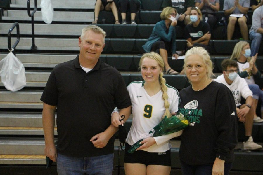 DRAGON POWER Before the volleyball team took on Millard South, Josie Mason (21) is recognized on senior night along side her parents and the rest of the seniors.