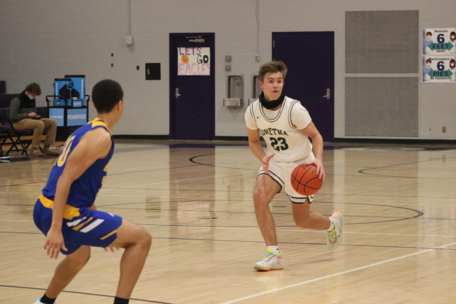 "Brand-New Challenge: Bringing the ball up, Landon Pokorski (24) played his first high school game with a large responsibility. ""It is a whole other level,"