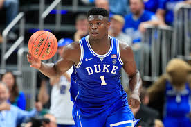 Zion Williamson, the number one pick in the 2019 NBA draft, brings the ball up the court against the University of Kentucky.