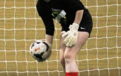 RED HOT Goalkeeper Kelsey Johnson (21) holds the ball, waiting for her teammates to get open.