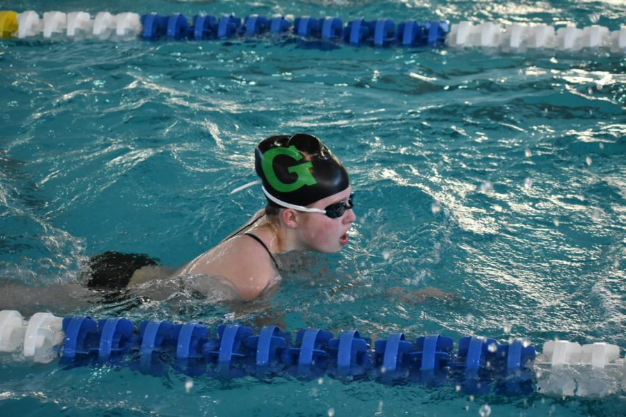 While+warming+up+for+the+Omaha+North+Dual%2C+junior+Julia+Otto+practices+drills+before+the+meet+starts.+%22The+first+meet+of+the+season+is+always+really+nerve-racking%2C%22+Otto+said.+%22But+it+helps+to+warm+up+before+it+starts+so+I+can+adjust+to+the+pool+and+loosen+up+before+I+swim.%22+The+team+won+against+Omaha+North+by+one+point.