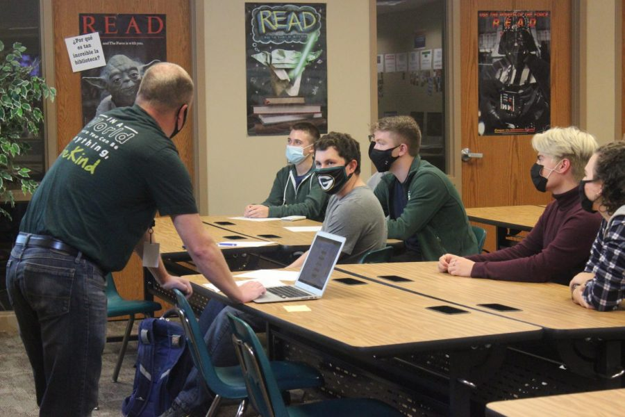 Helping his quiz bowl team, Paul Cornett (21) shares his best thoughts on the answers.