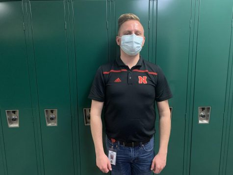 "Education Experience: In front of a set of green lockers stands student-teacher Mr. Jakob Henzi. "" With a music education degree, you have the ability to teach K-12 anything,"" Mr. Henzi said. ""I"