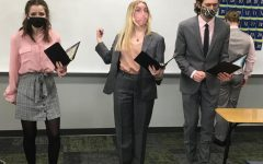 Bobby Wilson Before performing, Brooke Behrens (23), Avery Langholdt (21) and Gavin Egger (21) rehearse their OID entitled