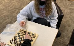 While playing a round of chess, Samantha Chase (21) analyzes the board for her next move. quote from sam Chase joined the chess club this year with her friends.