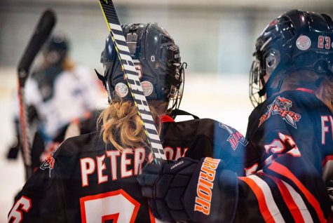 The Cornhusker State Games Female Athlete of the Year, is an award given to athletes that stand out, and work hard, and show real motivation. Calie Peterson (24) watches the game with her teammate.