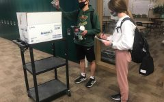 Staying Organized: At 3:00 p.m. on Friday, Feb. 12, Matthew McKinney (21) and Sarah Turpen (21) walked around the school to collect, count and tally up how many socks were in each first-hour sock box. I am the president of the student council, so that is why I was involved in the sock drive, Turpen said. My job was to advertise to fellow students as well as collect socks. The donated socks will be evenly distributed between Open Door Mission locations in Lincoln and Omaha.