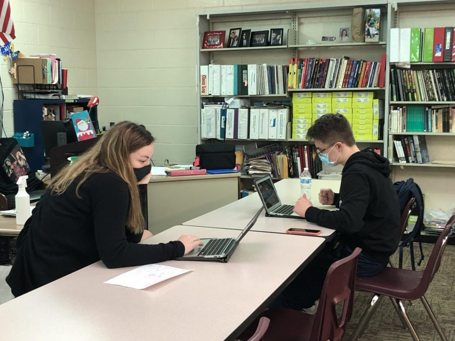 Working Hard: Copy Editor Avery Kallman (21) and Zane Mrozla-Mindrup (22), make the most of their class time to design pages for the yearbook.