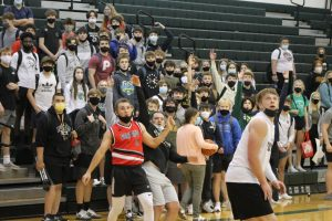 Crowd On Their Feet: With time running low in the fourth quarter, Mr. Jackson Hinze hoists a three point field goal.